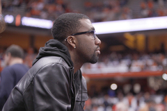 Former Syracuse basketball player Donte Greene watches from the crowd during SU's win over Eastern Michigan.