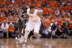 Michael Carter-Williams pushes the ball forward as Syracuse tries to increase the tempo.