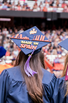 This student's Spain-themed cap features silhouettes of the Madrid and Barcelona skylines.