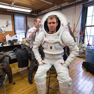 Andrzej Stewart, the chief engineering officer on the Mars simulation mission that ended this past August, suits up in the newly-designed spacesuit.