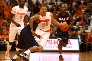 Brandon Triche looks to beat his defender in SU's 99-63 win Thursday.