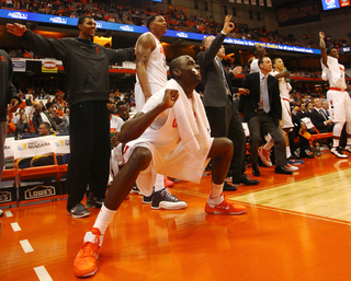 Baye Moussa Keita and the rest of the SU bench celebrate during the final moments of team's 99-63 victory.