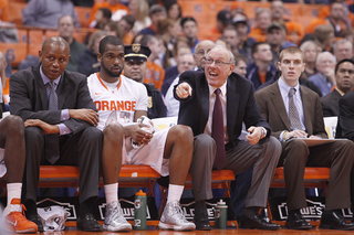 Jim Boeheim points out directions to his team from the bench.