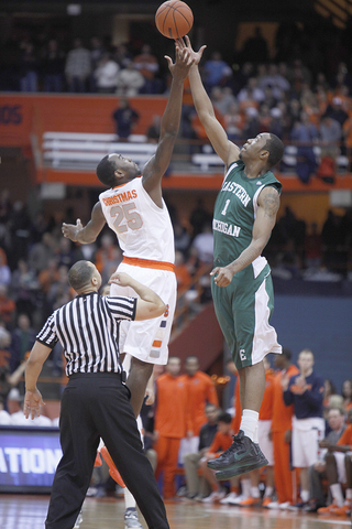 Rakeem Christmas goes up for the opening tip against Eastern Michigan.