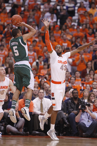 James Southerland leaps in an attempt to block a shot from Eastern Michigan guard Derek Thompson.