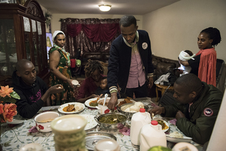 Every refugee settled by Interfaith Works enjoys a first meal with their host family.