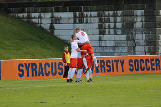 The Orange celebrates its second goal of the night, from Hagman, the junior attacking midfielder who finished second on the team in goals a year ago.