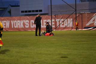 SU support staff assist with Castle's injury to the leg.